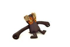 被手工造的风俗充塞了皮革玩具长期武装畸形人-离开 免版税库存照片