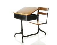 被打开的古色古香的学校书桌 免版税库存图片