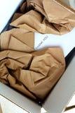 被打开的小包和礼品券里面 库存图片