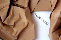 被打开的小包和礼品券里面 免版税图库摄影