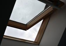 被打开的屋顶窗口 库存照片