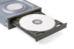 被打开的推进CD - DVD -与一张黑盖帽和盘,白色背景的蓝色光芒 免版税库存照片