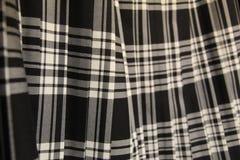 被打褶的苏格兰格子呢裙子 图库摄影