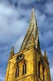 被扭转的教会尖顶 免版税库存图片
