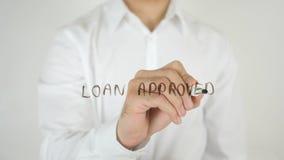 被批准的贷款,写在玻璃 免版税库存图片