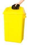 被投入的废入黄色容器 免版税库存照片