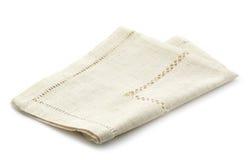 被折叠的亚麻布餐巾 免版税库存照片