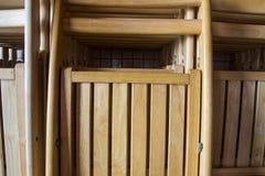 被折叠的木椅子 免版税库存图片