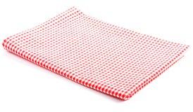 被折叠的红色方格的桌布 免版税库存照片
