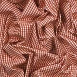 被折叠的红色检查布料 库存照片