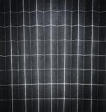 被折叠的黑纸的背景样式在128部分中 免版税图库摄影