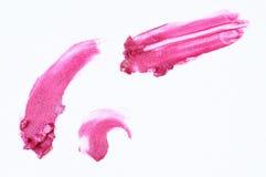 被抹上的桃红色唇膏 库存照片