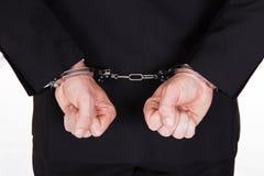 被拘捕的商人特写镜头  免版税库存图片
