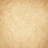 被按的棕色粗纸板纹理。木背景。 免版税库存照片