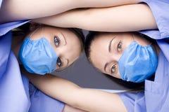 被挤作一团的护士 免版税库存图片