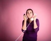 被捆绑的电话的妇女 免版税库存照片