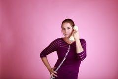 被捆绑的电话的妇女 库存照片