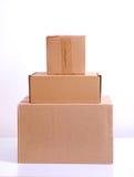 被排列被隔绝的三个纸板箱 库存照片