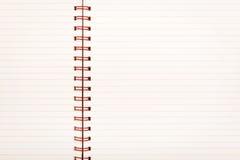 被排行的纸笔记本 免版税库存图片