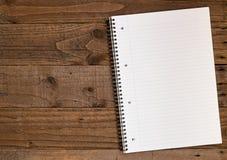 被排行的A4笔记本背景 免版税库存照片