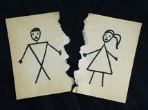 被撕开的男人和妇女图画 库存照片