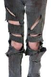 被撕毁的和血淋淋的牛仔裤 图库摄影