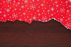 被撕毁的圣诞节装饰纸张 库存照片