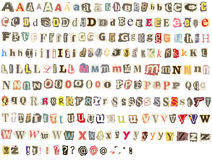 被撕毁的字母表报纸 图库摄影