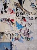 被撕毁的广告牌背景 图库摄影