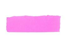 被撕毁的桃红色纸横幅。 库存图片