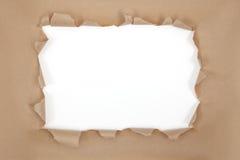 被撕毁的棕色框架纸张 免版税图库摄影