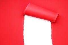 被撕毁的红色纸张 免版税库存照片