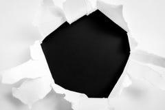 被撕毁的纸在黑背景 免版税图库摄影
