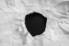 被撕毁的纸在黑背景 免版税库存图片