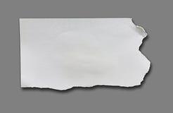 被撕毁的纸部分 库存图片