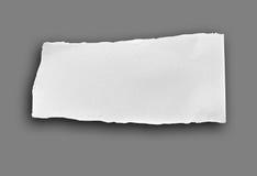 被撕毁的纸部分 免版税库存照片