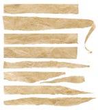 被撕毁的老被弄皱的纸片断,被剥去的磁带概略的标号组 免版税库存图片