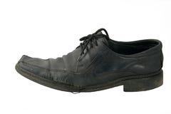 被撕毁的老鞋子 免版税库存照片