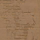 被撕毁的背景纸板被剥去的纹理 免版税库存图片
