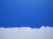 被撕毁的背景蓝纸 库存照片