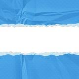 被撕毁的蓝色漏洞纸张端 免版税库存照片