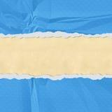 被撕毁的蓝色漏洞纸张端 免版税图库摄影