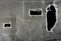 被撕毁的黑色牛仔布详细资料 免版税图库摄影