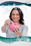 被放入存钱罐的金钱的综合图象由妇女 免版税库存图片