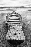 被放弃的当地泰国样式木头小船 免版税库存图片