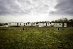 被放弃的野营的carvans 免版税图库摄影