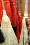 五颜六色的笤帚。 免版税库存照片