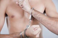 被束缚的手铐现有量 免版税库存图片