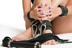 被束缚的腿和鞭子 图库摄影