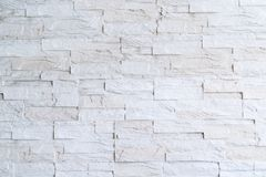 被构造的抽象石砖墙 免版税库存照片